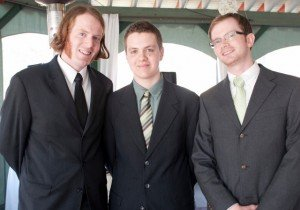 The two outside sons have graduate degrees. The son in the middle is a homeschool senior.